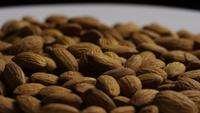 Cinematic, rotating shot of almonds on a white surface - ALMONDS 036