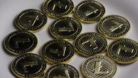 Rotating shot of Litecoin Bitcoins (digital cryptocurrency) - BITCOIN LITECOIN 0006