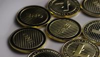 Rotating shot of Litecoin Bitcoins (digital cryptocurrency) - BITCOIN LITECOIN 0055