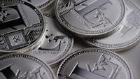 Rotating shot of Litecoin Bitcoins (digital cryptocurrency) - BITCOIN LITECOIN 0179