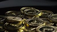 Rotating shot of Bitcoins (digital cryptocurrency) - BITCOIN LITECOIN 331