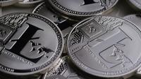 Rotating shot of Litecoin Bitcoins (digital cryptocurrency) - BITCOIN LITECOIN 0178