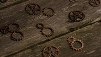 Rotating stock footage shot of antique and weathered watch faces - WATCH FACES 030