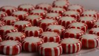Rotating shot of peppermint candies - CANDY PEPPERMINT 042