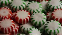 Rotating shot of spearmint hard candies - CANDY SPEARMINT 082