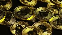 Rotating shot of Bitcoins (digital cryptocurrency) - BITCOIN 0091