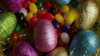 Rotating shot of Easter decorations and candy in colorful Easter grass - EASTER 017