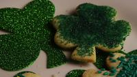 Rotating stock footage shot of St Patty's Day clovers on a white surface - ST PATTYS 010