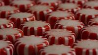 Rotating shot of peppermint candies - CANDY PEPPERMINT 044
