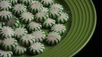 Rotating shot of spearmint hard candies - CANDY SPEARMINT 047