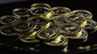 Rotating shot of Bitcoins (digital cryptocurrency) - BITCOIN LITECOIN 257