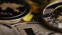 Rotating shot of Bitcoins (digital cryptocurrency) - BITCOIN MIXED 095