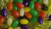 Rotating shot of Easter decorations and candy in colorful Easter grass - EASTER 007