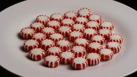 Rotating shot of peppermint candies - CANDY PEPPERMINT 033