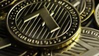 Rotating shot of Bitcoins (digital cryptocurrency) - BITCOIN LITECOIN 248