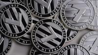 Rotating shot of Litecoin Bitcoins (digital cryptocurrency) - BITCOIN LITECOIN 0149