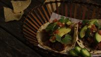 Rotating shot of delicious tacos on a wooden surface - BBQ 137
