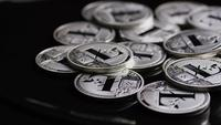 Rotating shot of Bitcoins (digital cryptocurrency) - BITCOIN LITECOIN 491