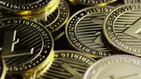 Rotating shot of Bitcoins (digital cryptocurrency) - BITCOIN LITECOIN 249
