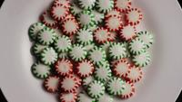 Rotating shot of spearmint hard candies - CANDY SPEARMINT 074