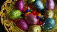 Rotating shot of Easter decorations and candy in colorful Easter grass - EASTER 019