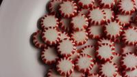Rotating shot of peppermint candies - CANDY PEPPERMINT 050
