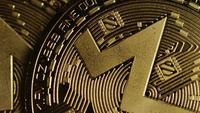 Rotating shot of Bitcoins (digital cryptocurrency) - BITCOIN MONERO 100