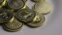 Foto giratoria de Litecoin Bitcoins (criptomoneda digital) - BITCOIN LITECOIN 0074