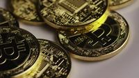 Rotating shot of Bitcoins (digital cryptocurrency) - BITCOIN 0396