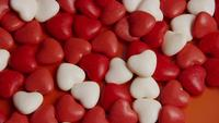 Rotating stock footage shot of Valentines decorations and candies - VALENTINES 0048