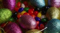 Rotating shot of Easter decorations and candy in colorful Easter grass - EASTER 018