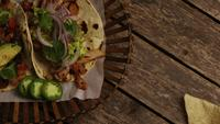 Rotating shot of delicious tacos on a wooden surface - BBQ 146