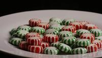Rotating shot of spearmint hard candies - CANDY SPEARMINT 086