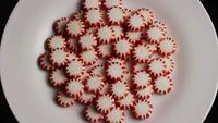 Rotating shot of peppermint candies - CANDY PEPPERMINT 048