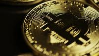 Rotating shot of Bitcoins (digital cryptocurrency) - BITCOIN 0095