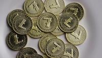 Rotating shot of Litecoin Bitcoins (digital cryptocurrency) - BITCOIN LITECOIN 0021