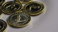 Rotating shot of Litecoin Bitcoins (digital cryptocurrency) - BITCOIN LITECOIN 0008