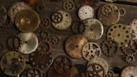 Rotating stock footage shot of antique and weathered watch faces - WATCH FACES 097