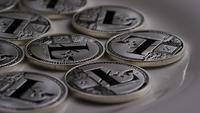 Rotating shot of Litecoin Bitcoins (digital cryptocurrency) - BITCOIN LITECOIN 0123