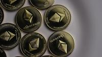 Rotating shot of Ethereum Bitcoins (digital cryptocurrency) - BITCOIN ETHEREUM 0061