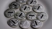Rotating shot of Litecoin Bitcoins (digital cryptocurrency) - BITCOIN LITECOIN 0114