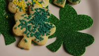 Rotating stock footage shot of St Patty's Day clovers on a white surface - ST PATTYS 012