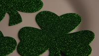 Rotating stock footage shot of St Patty's Day clovers on a white surface - ST PATTYS 006
