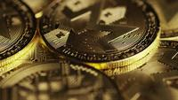 Rotating shot of Bitcoins (digital cryptocurrency) - BITCOIN MONERO 113