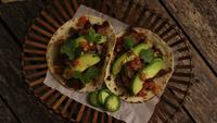 Rotating shot of delicious tacos on a wooden surface - BBQ 127