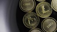 Rotating shot of Bitcoins (digital cryptocurrency) - BITCOIN LITECOIN 272