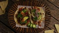 Rotating shot of delicious tacos on a wooden surface - BBQ 143