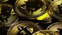 Rotating shot of Bitcoins (digital cryptocurrency) - BITCOIN 0093