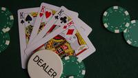 Rotating shot of poker cards and poker chips on a green felt surface - POKER 011