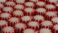 Rotating shot of peppermint candies - CANDY PEPPERMINT 035